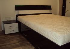 Кровать с гнутой спинкой 010